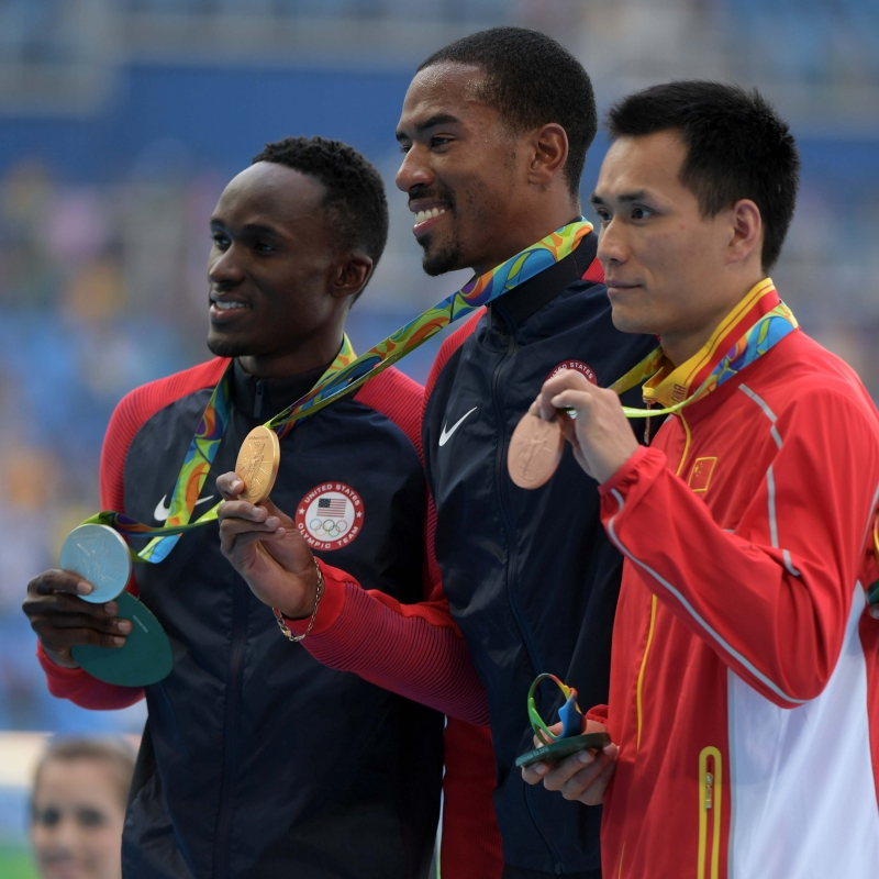 Medal stand- Will Claye(silver) and Bin Dong(Bronze)